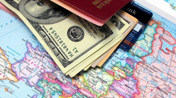 Паспорт, доллары и карта Европы