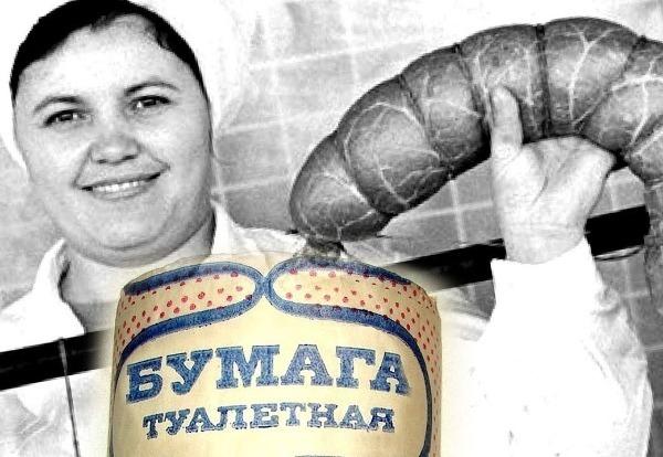 Советская работница производства держит батон колбасы
