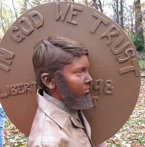 Мальчик в образе Линкольна на центе